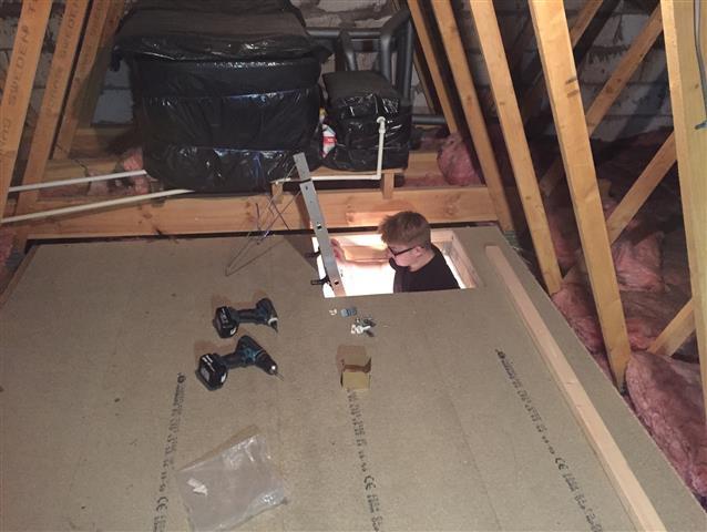 Loft boarding and ladder installation in progress